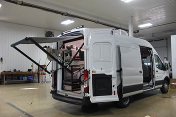 Ford Transit with Custom Red and a Canopy
